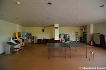 Entertainment room incl half a dozen arcade machines at an abandoned hotel