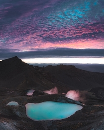 Entirely alone atop the Tongariro Alpine Crossing moments before sunrise New Zealand
