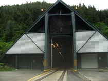 Entrance to Alaskas Whittier Tunnel a unique km tunnel that uses scheduling to share a single lane between both road vehicles and trains