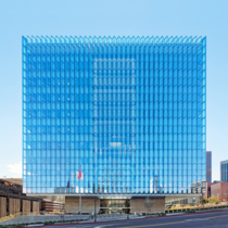 Envisioned as a floating cube Skidmore Owings amp Merrills new United States courthouse in downtown Los Angeles The building is designed as a glass clad cube that hovers over a stone base