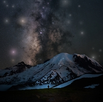 Epic view of the climbers amp their headlamps make progress towards the summit of Mt Rainier Washington underneath the Milky Way