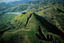 Erosion on the slopes of a volcano near Ankisabe Madagascar  by Yann Arthus-Bertrand