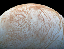 Europa the smallest of Jupiters Galilean moons It is primarily made of silicate rock and has a water-ice crust and an ironnickel core as well as a very thin atmosphere composed mostly of oxygen  image NASAJPL