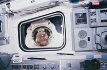 Even in space there are creepers Mission specialist Rick Hieb peers into the flight deck