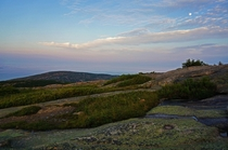 Evening light and waxing moon on Cadillac Mountain in Maines Acadia National Park Maine