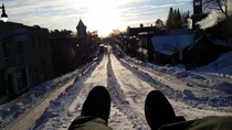 Every year my town turns the hill on the main street into a tube run for a day in January Muskoka Canada