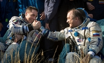 Expedition  Flight Engineer Chris Cassidy left and Commander Pavel Vinogradov of Russian Federal Space Agency shake hands after they landed their Soyuz TMA-M spacecraft