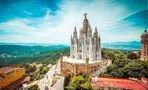 Expiatory Church of the Sacred Heart of Jesus - Barcelona Spain - Built from  to  by Spanish architect Enric Sagnier - The appearance of the church is of a Romanesque fortress of stone from Montjuc the crypt topped by a monumental Neo-Gothic church access