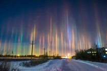 Extremely Rare Light Pillars in Russia dazzling optical phenomenon caused when light is refracted by ice crystals These pillars tend to take on the color of the surrounding light source