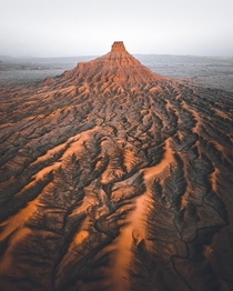 Factory Butte is one of Utahs extremely diverse and beautiful landscapes Best seen from the air  OC insta erik_young