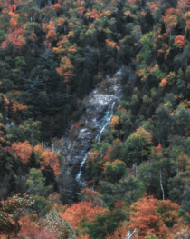 Fall foliage and hidden waterfalls deep in the forests near Lake Placid NY