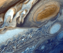 False-color detail of Jupiters atmosphere imaged by Voyager  showing the Great Red Spot and a passing white oval