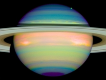 False-color image of Saturn shows the planets reflected infrared light The blue colors indicate a clear atmosphere down to a main cloud layer Different shadings of blue indicate variations in the cloud particles in size or chemical composition Erich Karko