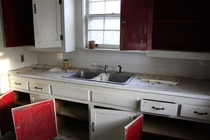 Fantastic red cabinet interiors of the kitchen in this quaint abandoned house