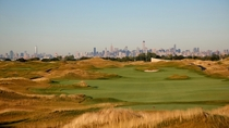 Ferry Point golf course with background of Manhattan skyline