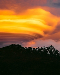 Fiery lenticular clouds sitting above The Remarkables Queenstown One of only two mountain ranges in the world which run directly north to south x
