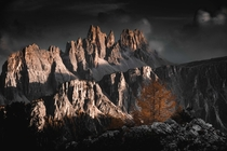 Fiery peaks one autumn sunset over the Dolomites looking out from Cinque Torri Dolomites Italy  OC IG arvindj