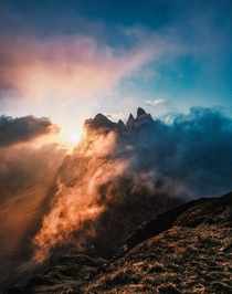 Fiery sunrise above the clouds at Seceda Italy