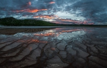 Fiery sunset reflected over the tendrils of the Grand Prismatic Spring Yellowstone