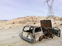 Final resting grounds of an old Jeep rusting out in the dry desert of Indio California