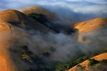 Fingers of fog flowing over the Diablo Foothills