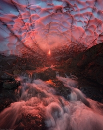 Fire and Ice A huge ice cave under Mutnovskiy volcano Kamchatka  Photo by Daniel Kordan