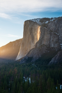 Firefall in Yosemite National Park California - this is a natural phenomenon when the sun hits the face of El Capitan at just the right angle to illuminate Horsetail Fall and make the water look like lava