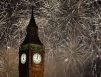 Fireworks explode across the London skyline and Big Ben