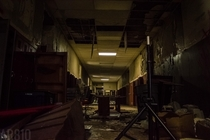 First floor hallway of a high school founded in  with power still running through certain circuits Flint MI