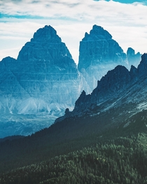 First light hitting the mountains of Tre Cime di Lavaredo in Italy