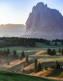 First light hitting the valley of Alpe di Siusi in the Dolomites Italy
