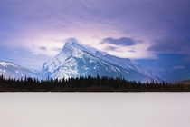 First person I showed this to asked Why isnt the bottom part of the image loading Banff lights up Mt Rundle in the Canadian Rockies Taken from Vermilion Lakes last winter
