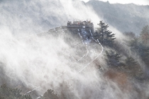 First snow over Beijing yesterday Great Wall at MuTianYu The wind blows the snow from the trees