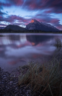 First sunlight hitting Mount Rundle from the Vermillion lakeshore