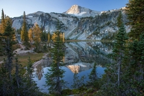 First touch of Sun on Eagle Cap Peak reflected in Mirror lake Eagle Cap Wilderness OR