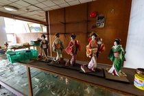 Five Geisha dolls found on a display case in an abandoned Japanese coastal hotel chrisluckhardt