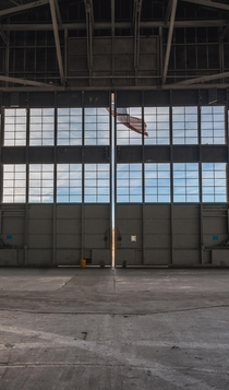 Flag hanging from an abandoned naval airbase hangar