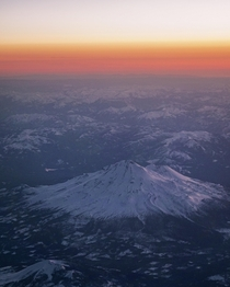 Flew over Northern California yesterday and took this picture of what I believe is Mount Shasta during sunset