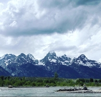 Floating the Snake River flowing beside the Grand Tetons Wyoming USA