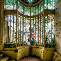 Floral stained glass window at the abandoned Chteau Astremoine in France photo by Urbex