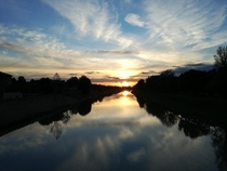Florence Italy Sunset reflecting on the river arno from the passerella delle cascine bridge
