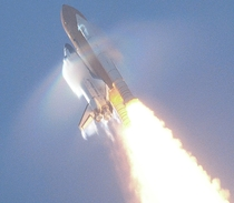 Florida USA Atop gigantic pillars of fire NASAs Space Shuttle Atlantis STS- -- sporting Prandtl-Glauert condensation due to the Prandtl-Glauert Singularity and sprouting shock waves -- majestically soars towards space on  September