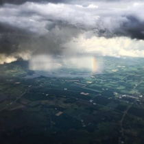 Flying into a Storm Madison WI and got this amazing shot of storm and rainbow