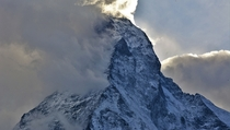 Fog rolling off of the Matterhorn in the evening Zermatt Switzerland