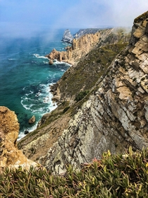Fog rolling up the cliffs Cabo da Roca Portugal  x