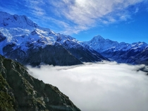 Fog started rolling in and now it looks like a lake made out of clouds - Sealy Tarns Track Mount Cook National Park in New Zealand -