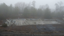 Foggy day at abandoned Olympic-size swimming pool in rural South Carolina  Album in comments