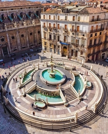 Fontana Pretoria a th century monumental fountain in the historic centre of Palermo surrounded by a th century Baroque church and a th century palace Sicily southern Italy