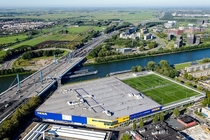 Football pitches and clubhouse on an IKEA parking garage Utrecht the Netherlands
