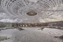 Footsteps imprinted in the snow inside the abandoned House of the Bulgarian Communist Party  By Rano Pano